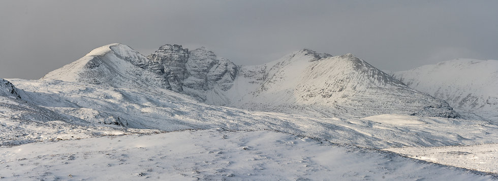 Panoramic of a snow covered An Teallach.