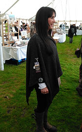 Highland Poncho knitted in a merino silk mix by Elizabeth Larsen Knitwear. Knitwear made in Scotland.