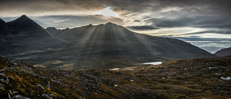 Light rays over a moody Liathach