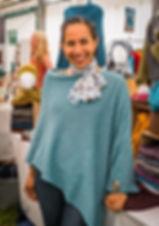 Real Customer wearingHigland poncho knitted by Elizabeth Larsen Knitwear. Knitwear designed and mde in Scotland.
