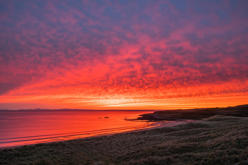 Red sky at night over theMinch and the Western Isles from Opinan Beach