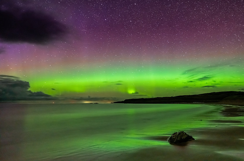 Aurora with a slight tower over Opinan Beach, Wester Ross.