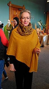 Torridon poncho andautumn in the glen cowl knitted by Elizabeth Larsen Knitwear. Knitwear made in Scotland.