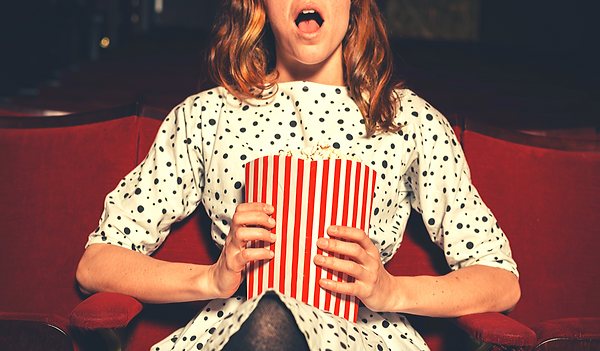 Woman with popcorn image.png