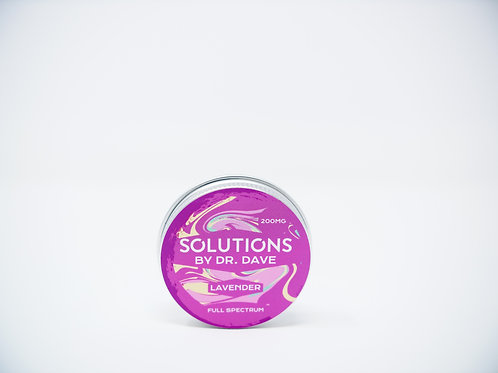 Tin of CBD balm with a purple label
