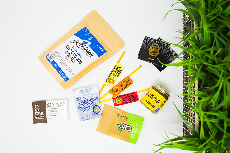 CBD teas, CBD honey sticks, and other CBD edibles are displayed against a white background