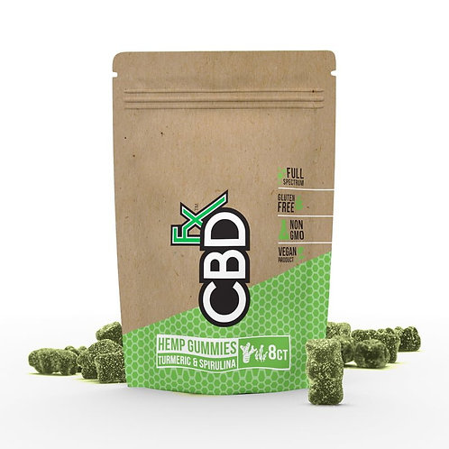 Brown and green paper pouch with green CBD gummies laying around it
