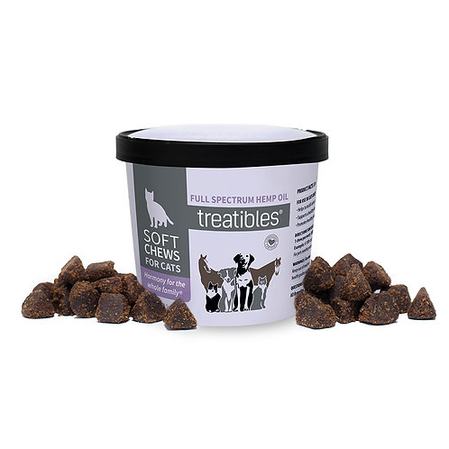 Purple container of CBD dog treats surrounded y small brown dog treats