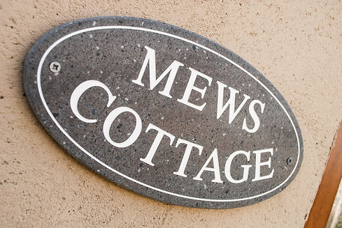 Mews Cottage at Cloverfields sign