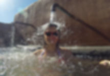 Oona Tibbetts, Wild SUP Tours manager, under a water spigot