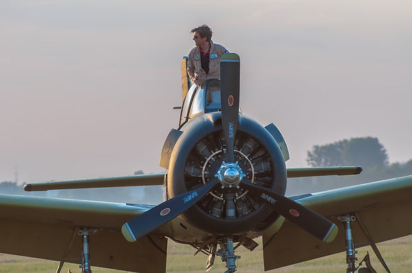 Tomek Marchewka photo RS standing in T-28 cockpit front view.jpg
