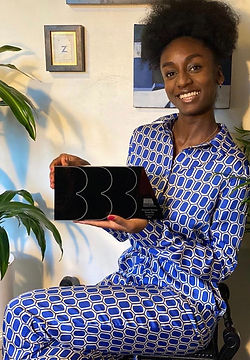 Zainab holding her Black British Business Award for Financial Services Rising Star