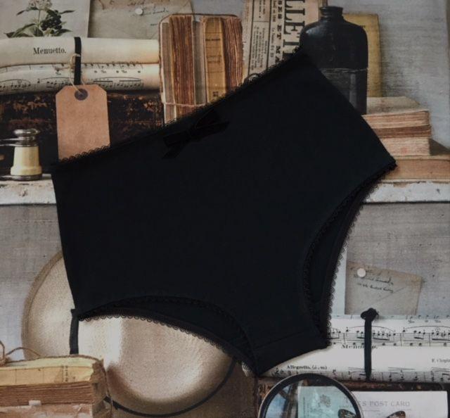 Claudette in black