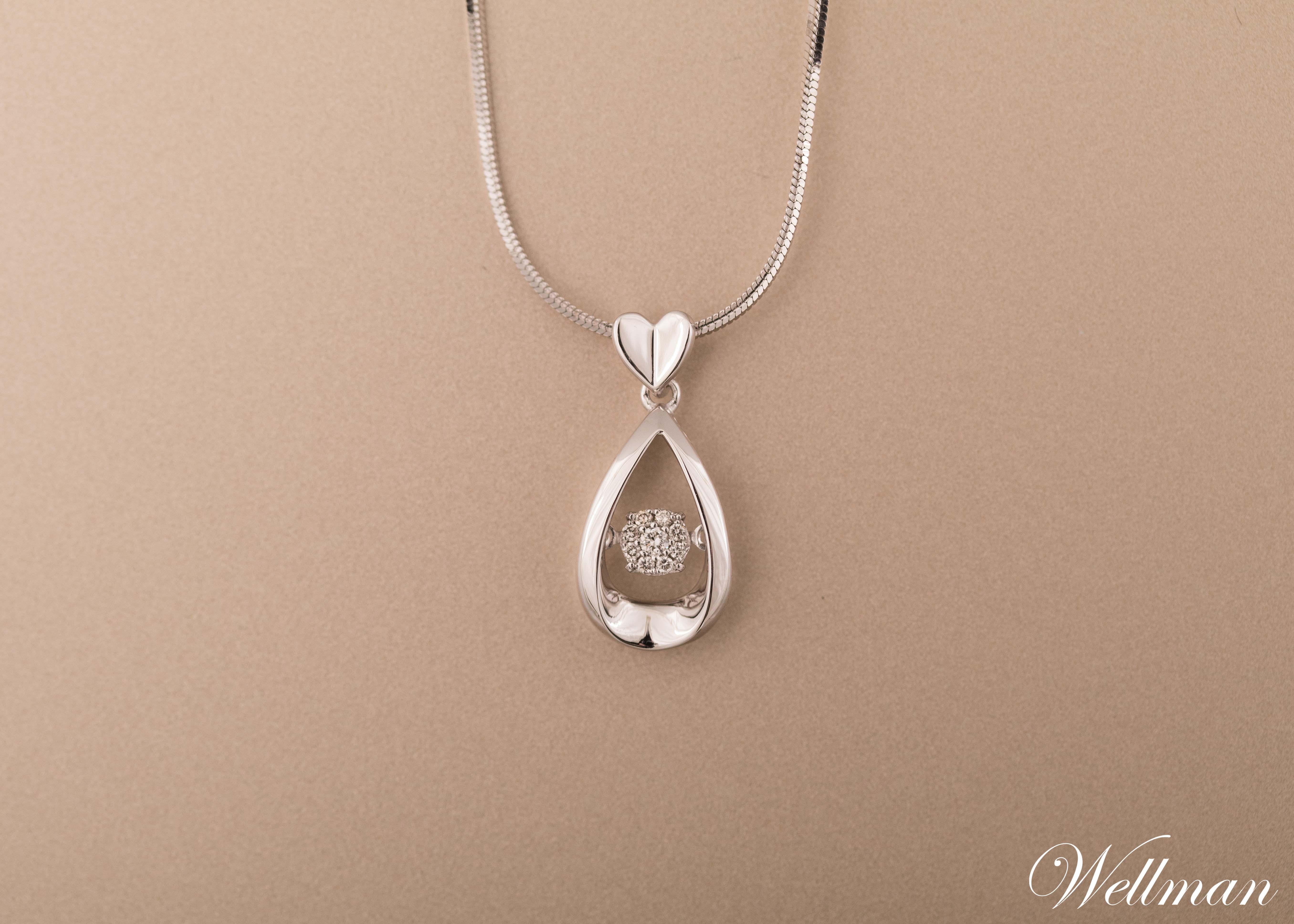 Dancing Diamond Pendant