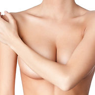 a woman's nude upper body, arms covering breasts