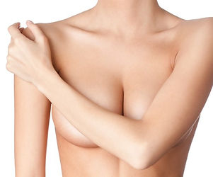 topless woman crossing her arm to cover her breasts - torso view