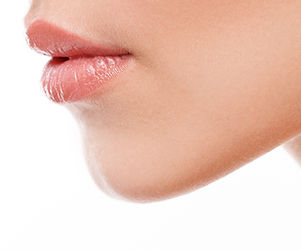 detail of attractive woman's lips and chin