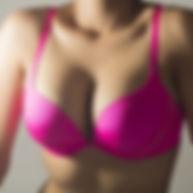 woman's upper body in a dark pink bra