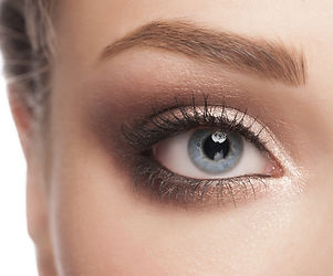 detail of a woman's face - steel blue eye with attractive, dark eye shadow,mascara, and eyebrow pencil