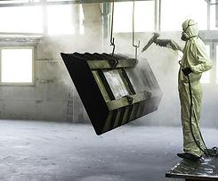 Worker sabbiatura metallo Pezzo