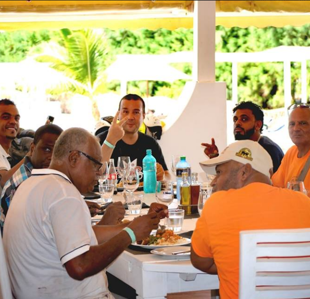 The winner of the quad category Fabio Colombo with some other riders enjoying their lunch at Kola Beach