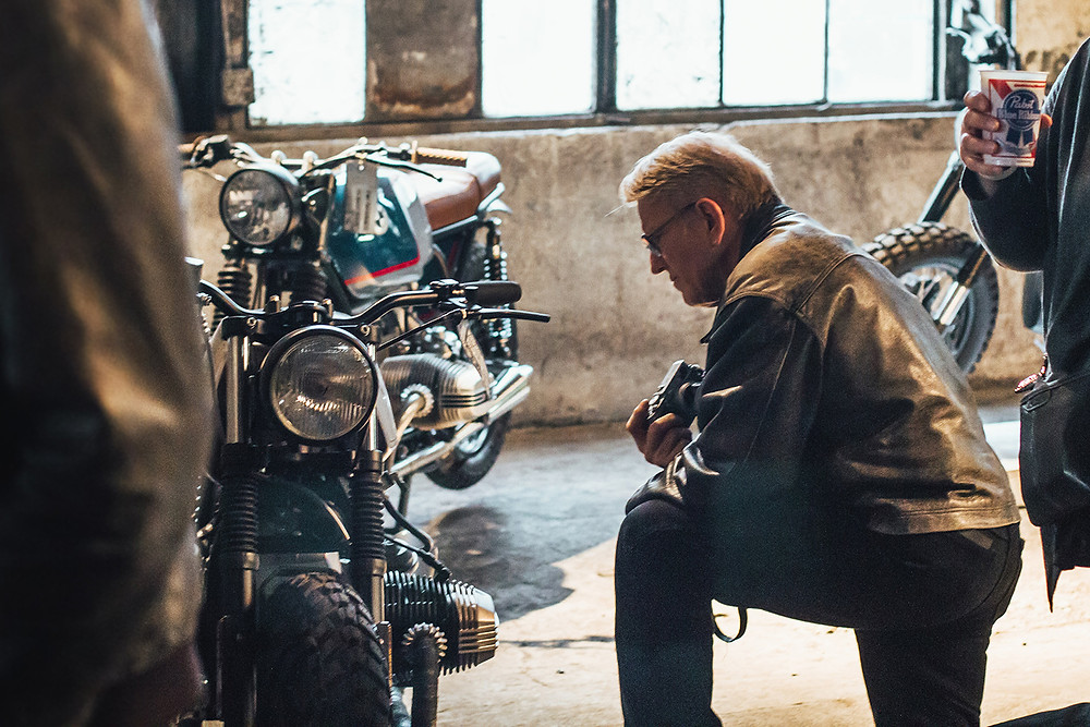 Man Prays At The One Motorcycle Show in Portland, Oregon