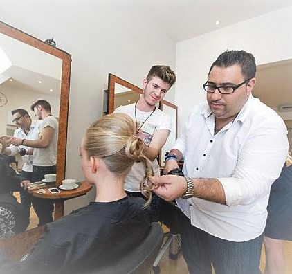 Tas training one of our most successful salon assistants