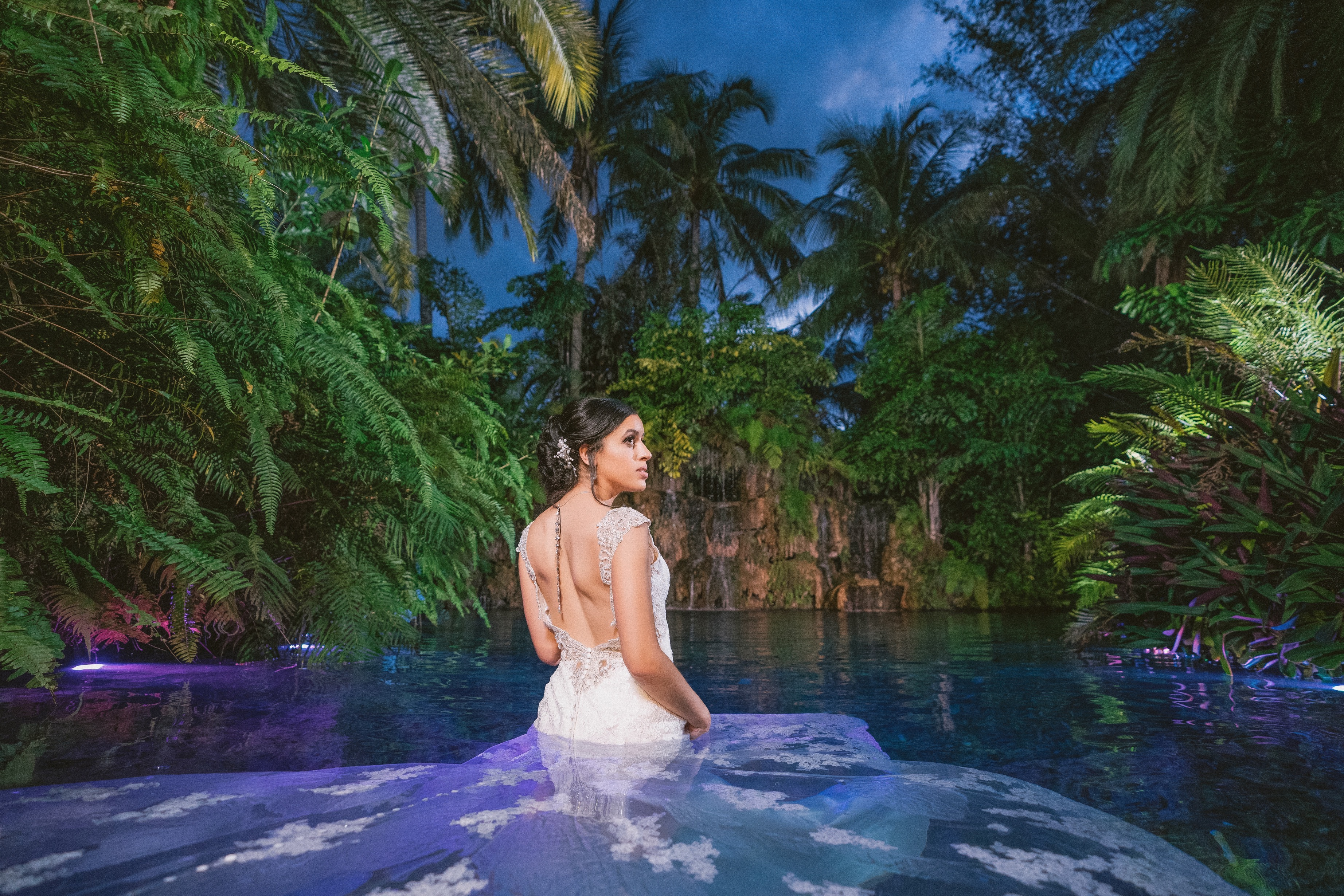 bride inside the water in dress