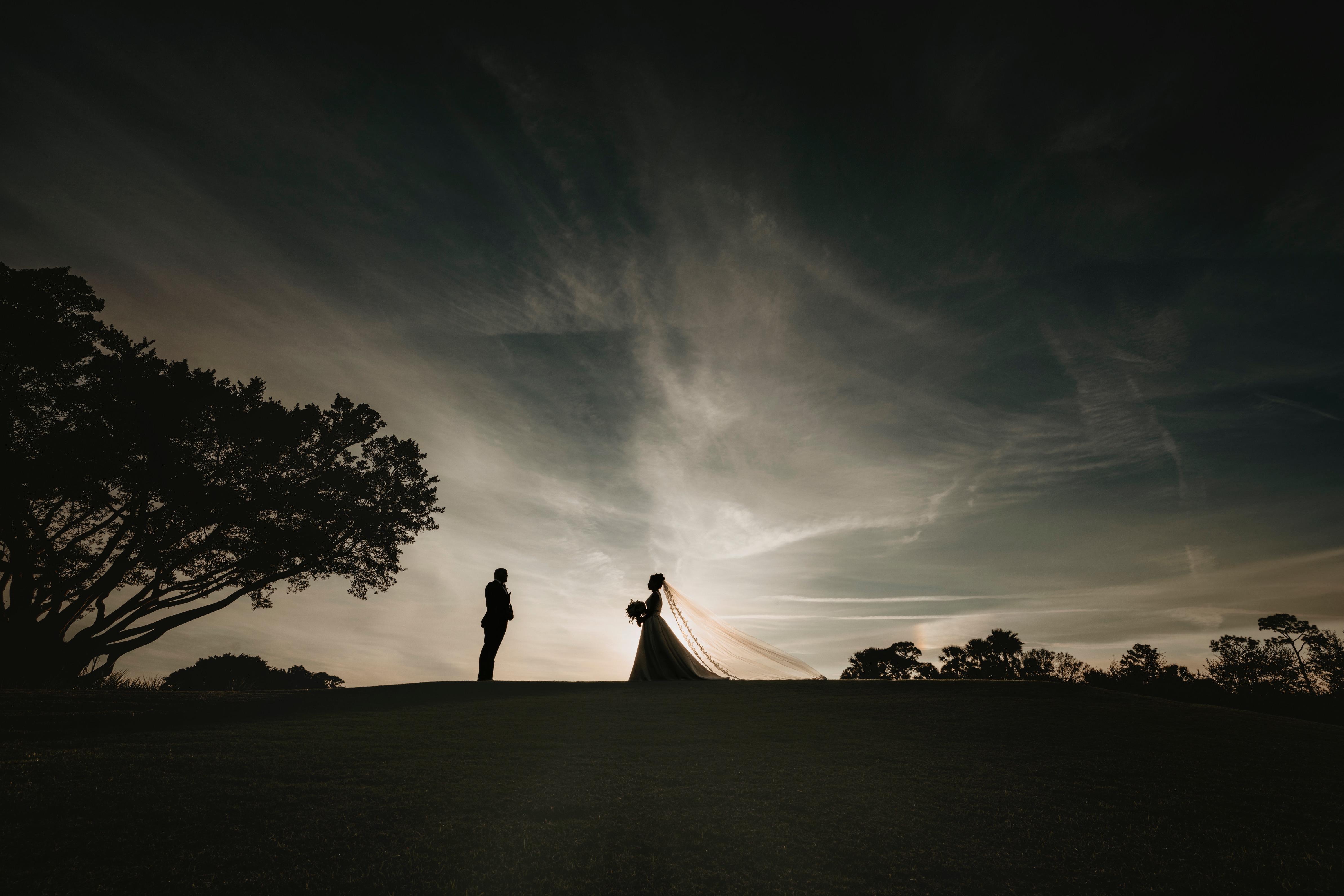 Bride and Groom Walking on Sunset Breake