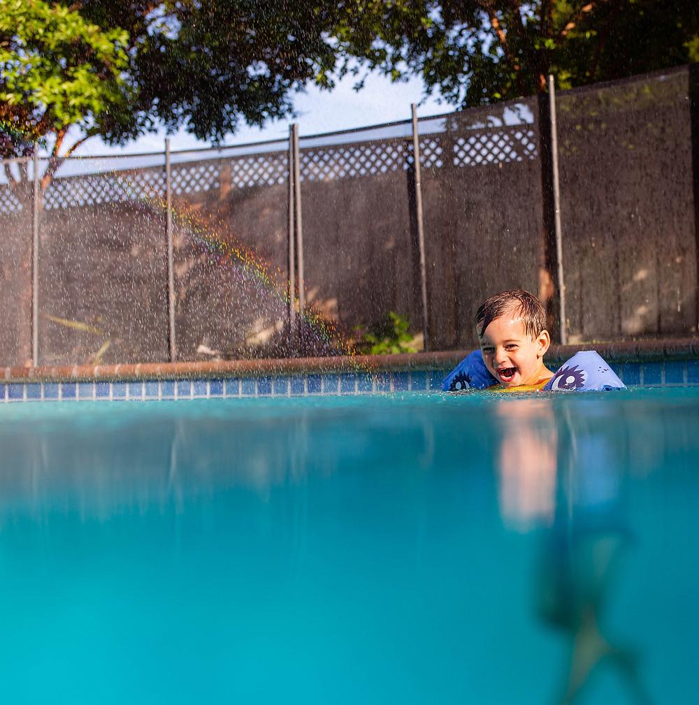 little boy having fun in pool