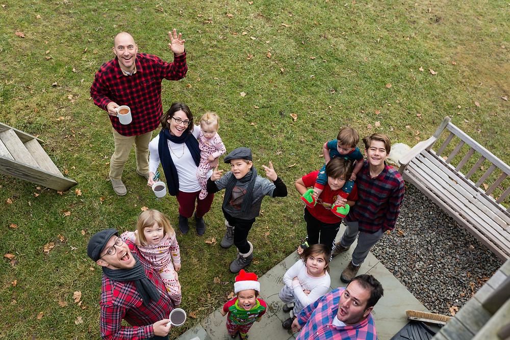 family looking up at camera