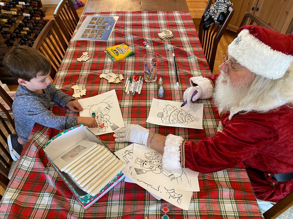coloring with Santa, plaid tablecloth, boy, Santa, wine rack