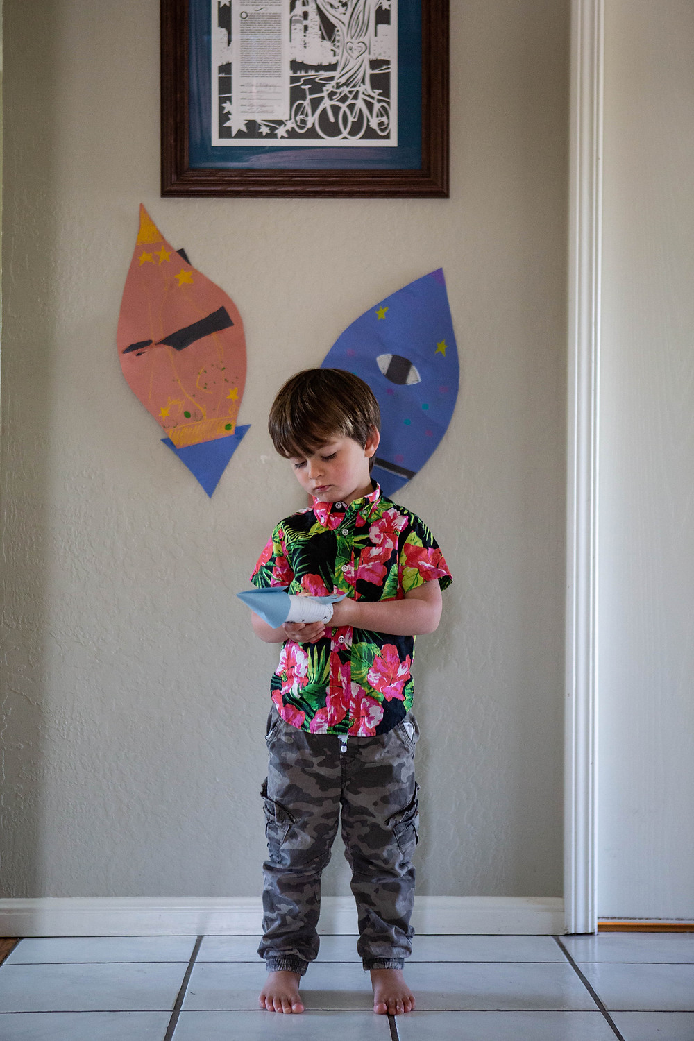 toddler boy, Hawaiian shirt, toilet paper roll spaceship