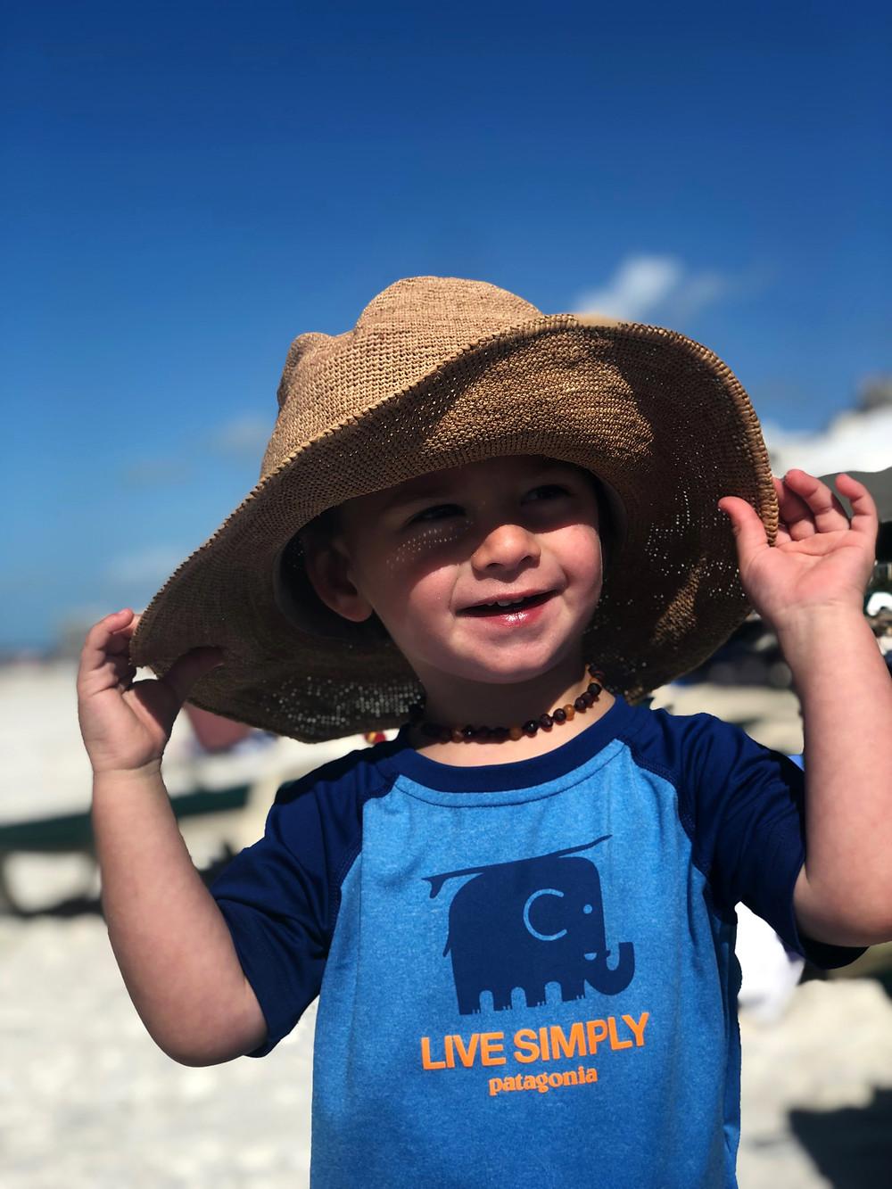 toddler boy wearing beach hat
