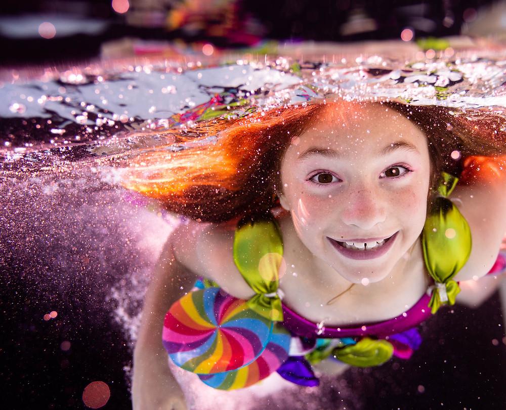 San Jose underwater photography, pool, blue pool, lollipop dress, girl, brown hair, brown eyes, concept photo shoot