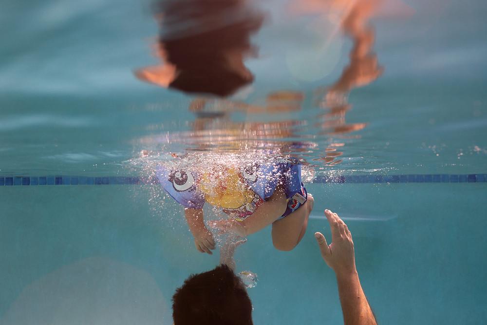 underwater image of child swimming
