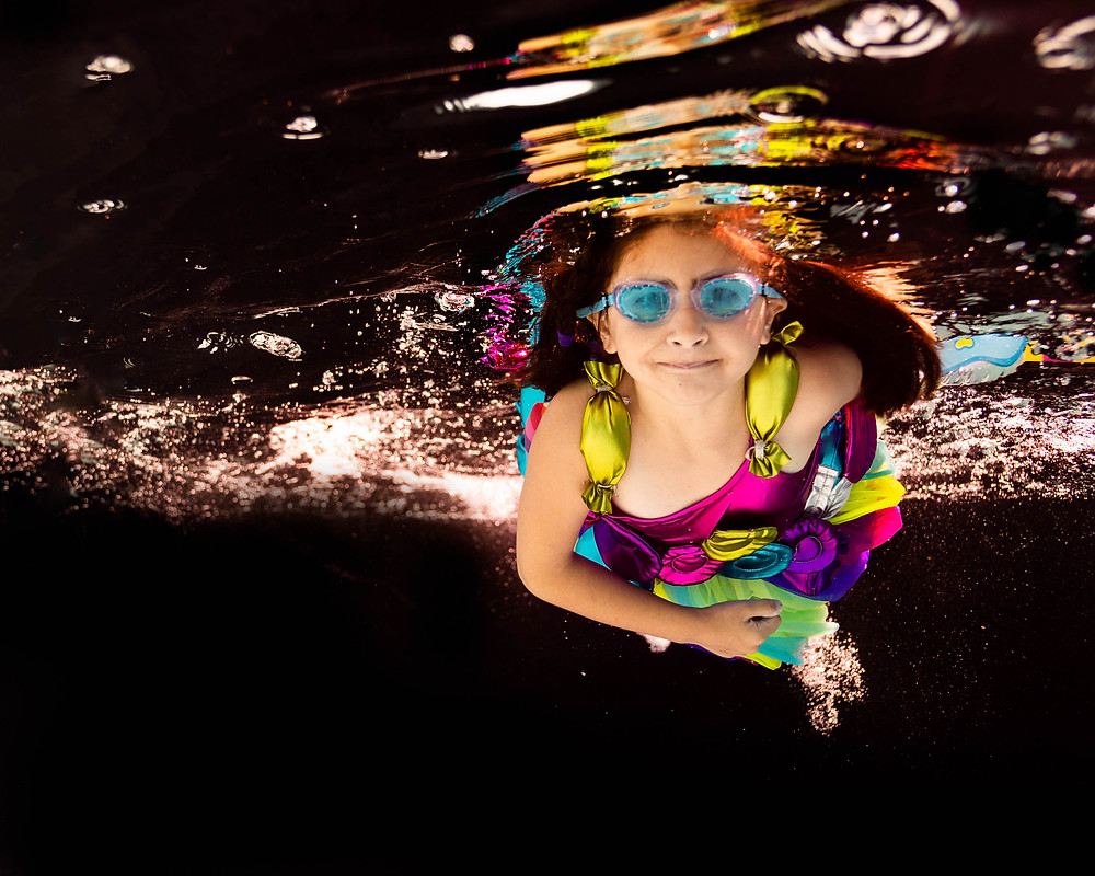 black backdrop, underwater photo, lollipop dress, Chasing Fireflies, blue goggles, girl
