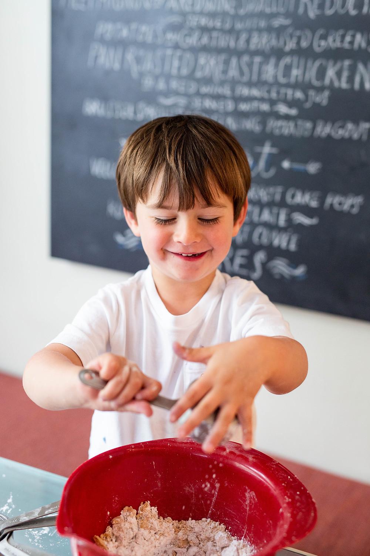 toddler boy baking, red mixing bowl