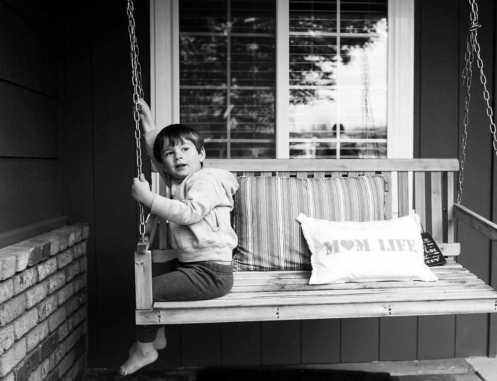 black and white portrait, porch swing