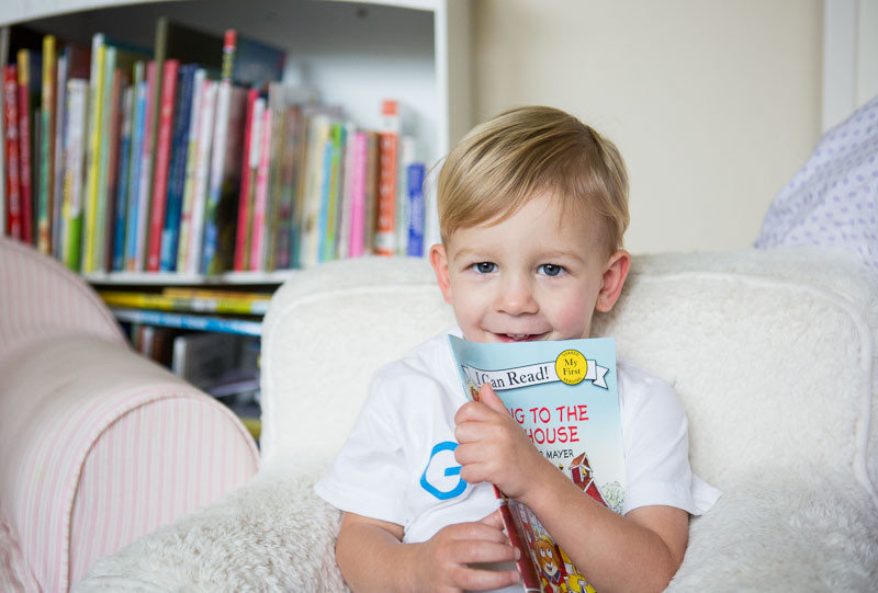 smiling little boy with his favorite book