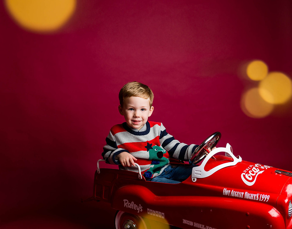 Santa mini sessions 2019, Coca Cola red car for kids, smiling boy, Christmas pajamas
