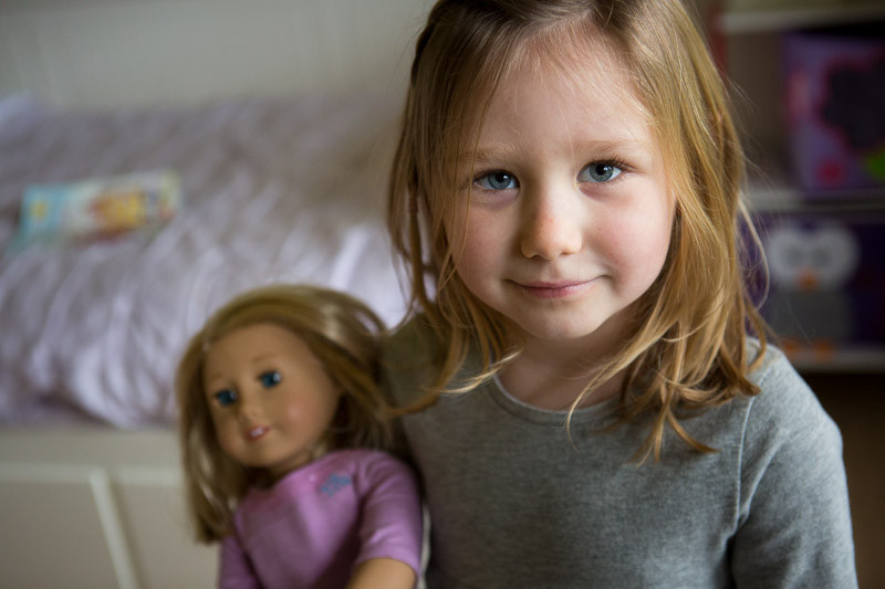 sweet girl with favorite american girl doll