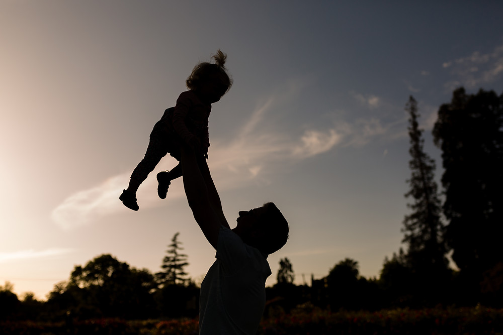 father child sunset silhouette