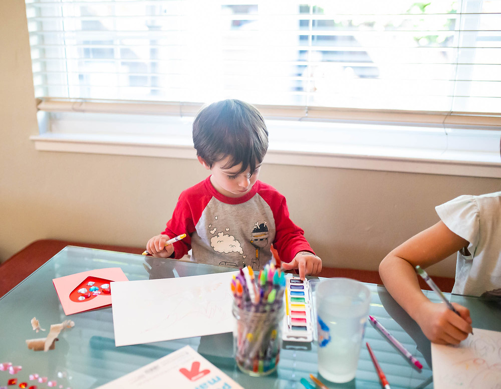 Valentine's Day, activities for kids, toddler boy, water color paints, Valentine's Day card, paint brushes, cup of water