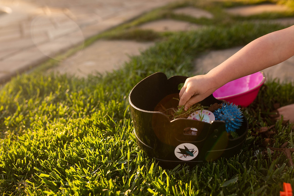 toddler boy playing outside, golden hour