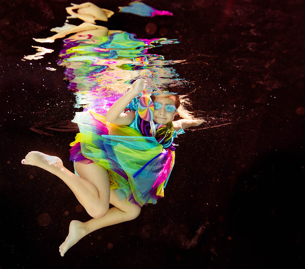 black backdrop, underwater picture, concept photo shoot, Candyland, legs, tulle skirt, rainbow