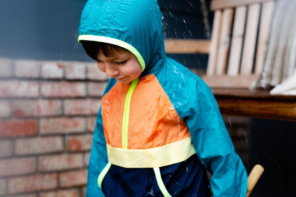 little boy playing in the rain, San Jose, CA