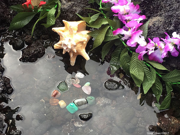 Charging and cleansing reiki crystals in ocean water from Hawaii.