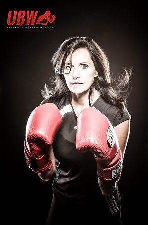 Jamie boxing pose - red logo.jpg