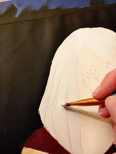 person paining a portrait.